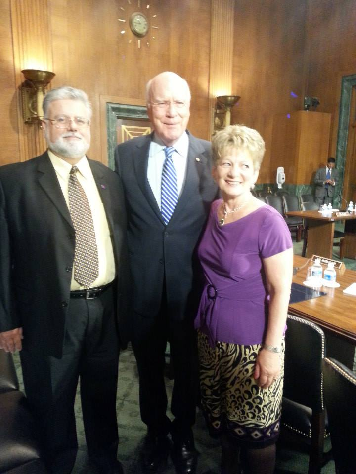 Senator Patrick Leahy stands with the law's namesake, survivor Debbie Smith and her husband Rob.