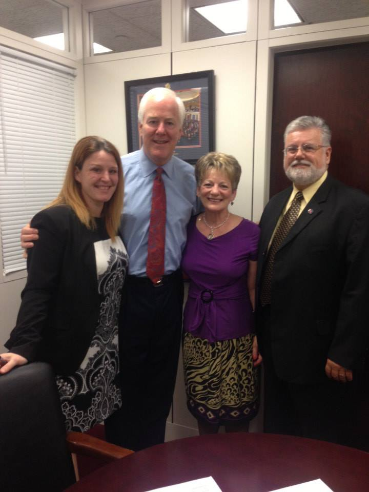From left Rebecca O'Connor, VP of Public Policy for RAINN and Senator John Cornyn stand with the law's namesake, survivor Debbie Smith and her husband Rob.