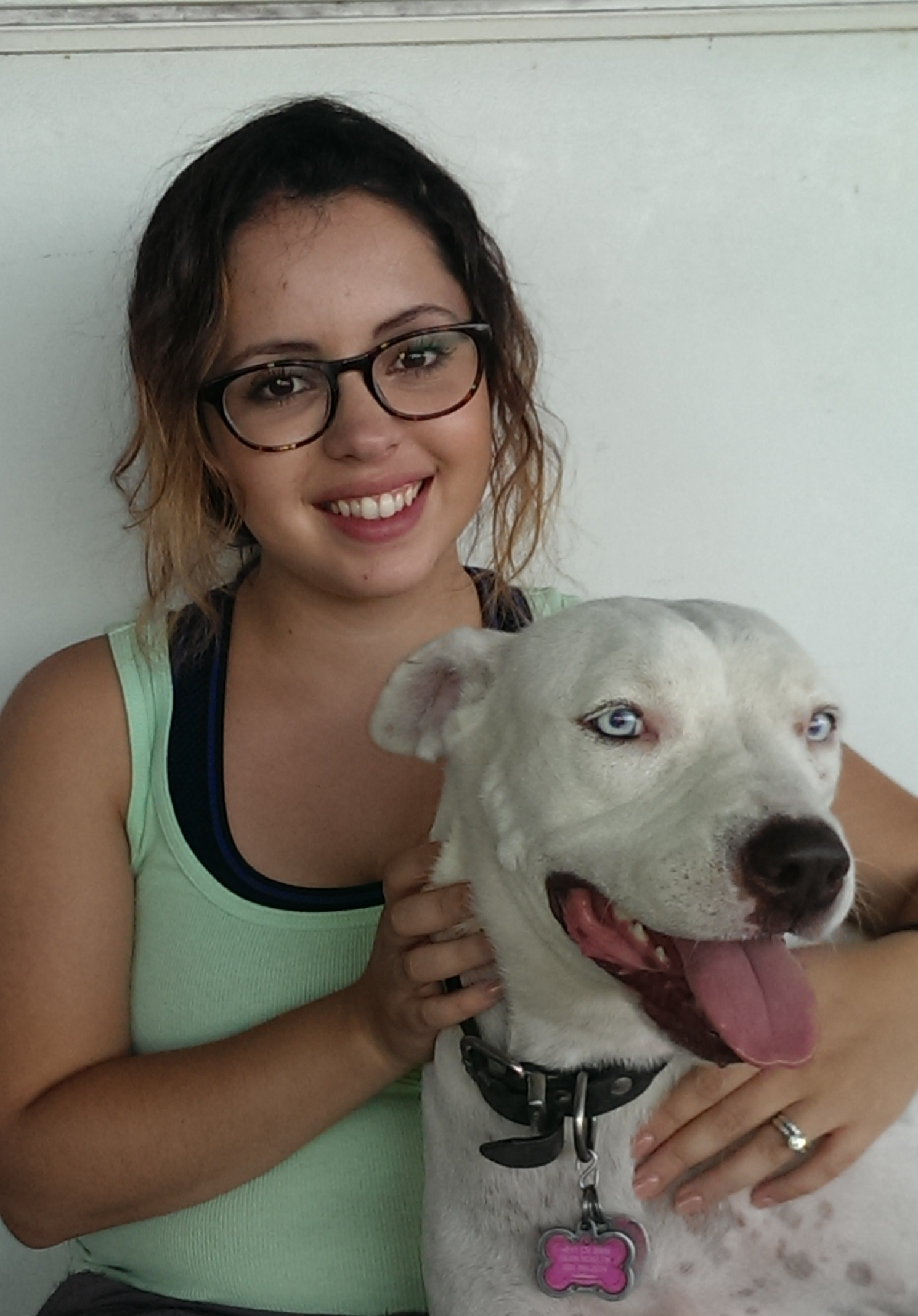 Sexual assault survivor Adriana holds her rescue dog Milli.