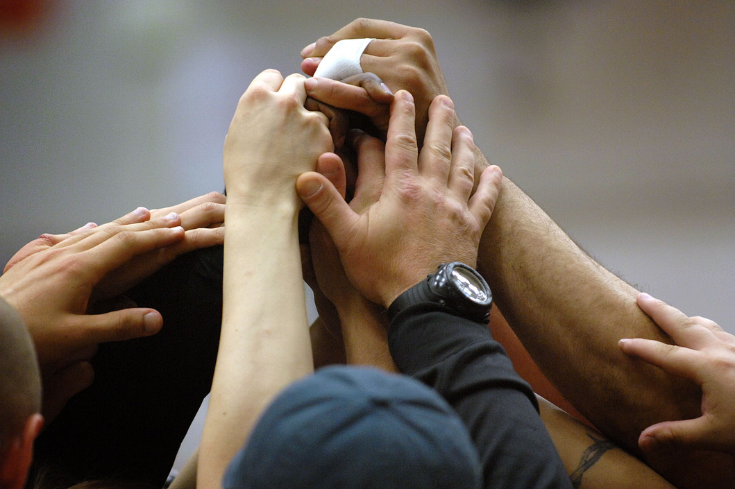 Seven Things You Can Do This April. Mar 23, 2015. A group of people have their hands together in the air in a group cheer