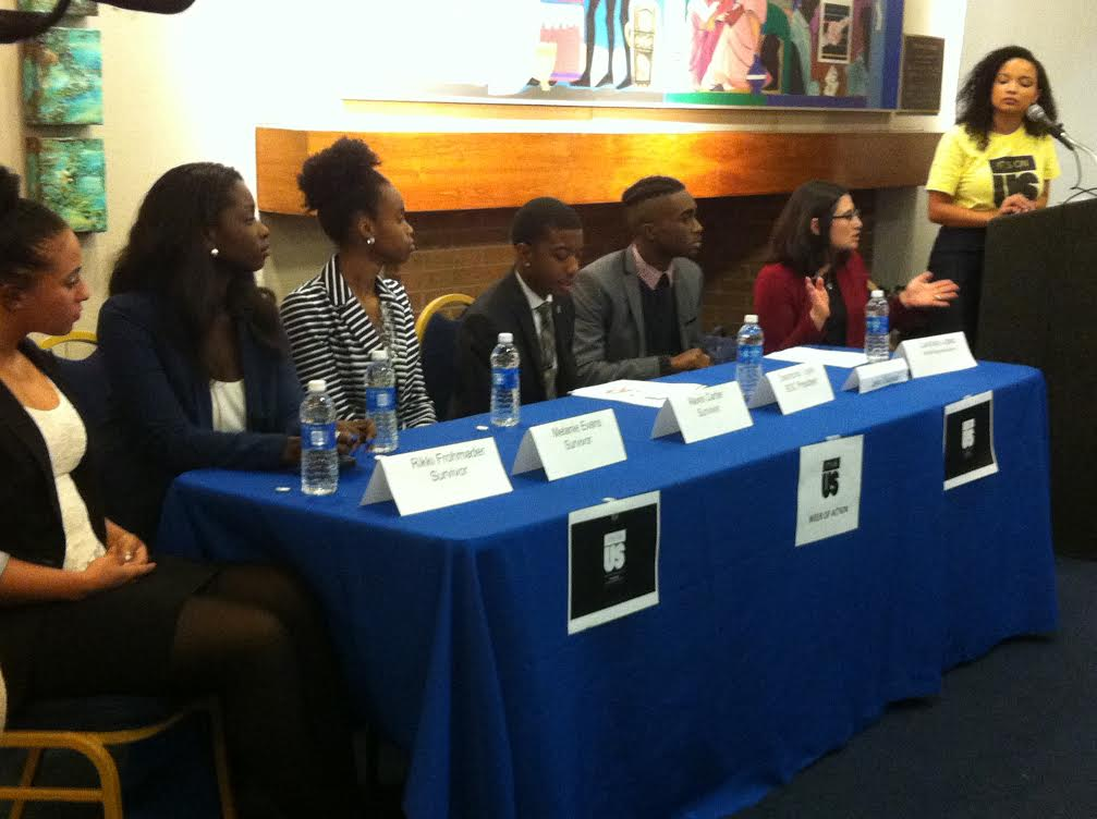 Panelists sit at a table during an event about sexual assault on campus