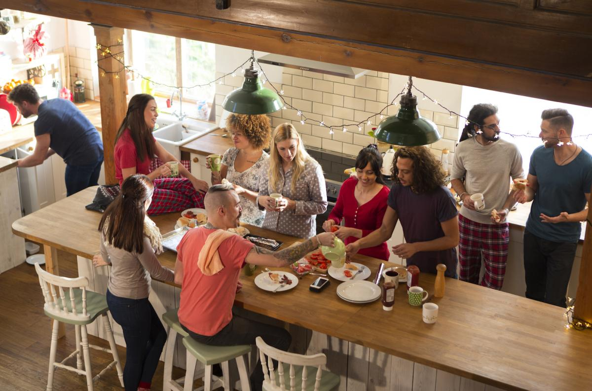 Family and friends gather for a holiday meal, respecting each other's boundaries.